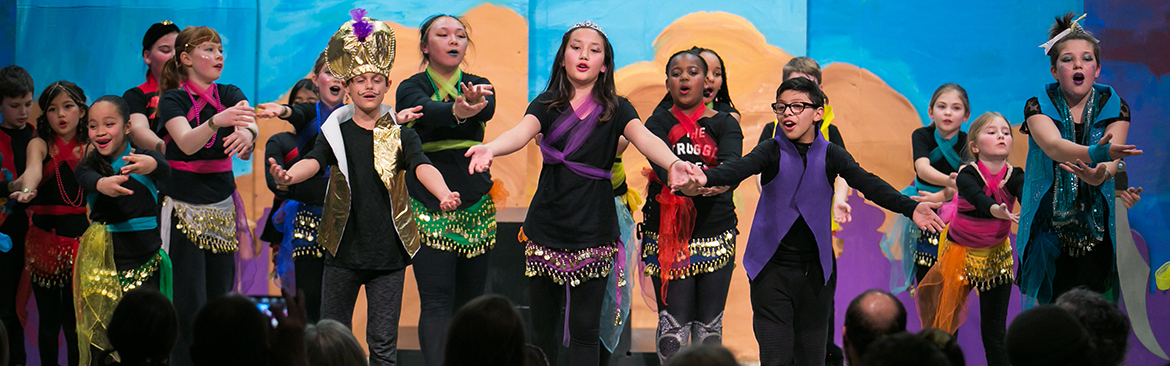 Hawthorne Elementary students perform on stage.