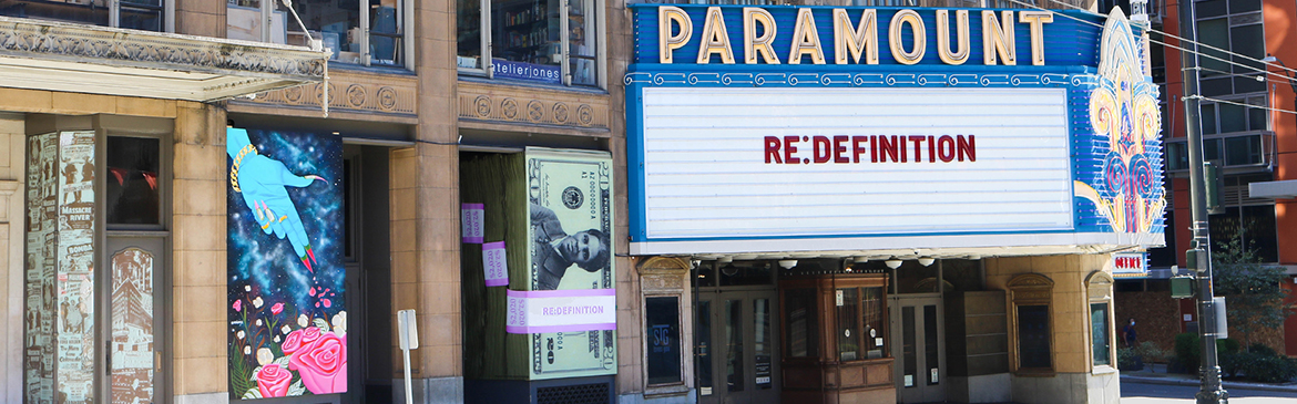 Paramount Theatre marquee reads RE:DEFINITION with accompanying murals, photo by Kina Ackerman
