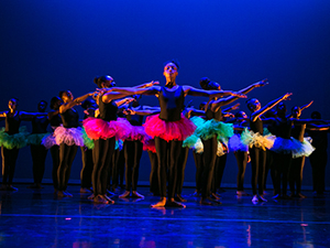 Dancers in formation on stage