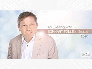 Eckhart Tolle wearing a blazer, looking at the camera.