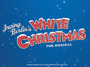 Irving Berlin's White Christmas The Musical in white and red text, against a blue background, with falling snow.