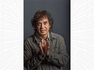 Zakir Hussain looking at the camera