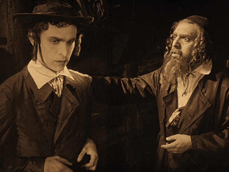 Screen shot of two actors from The Ancient Law.
