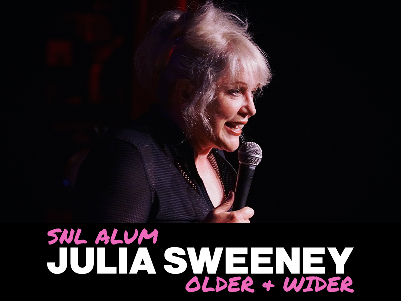 Julia Sweeney holding a microphone with text: SNL Alum Julia Sweeney Older + Wider