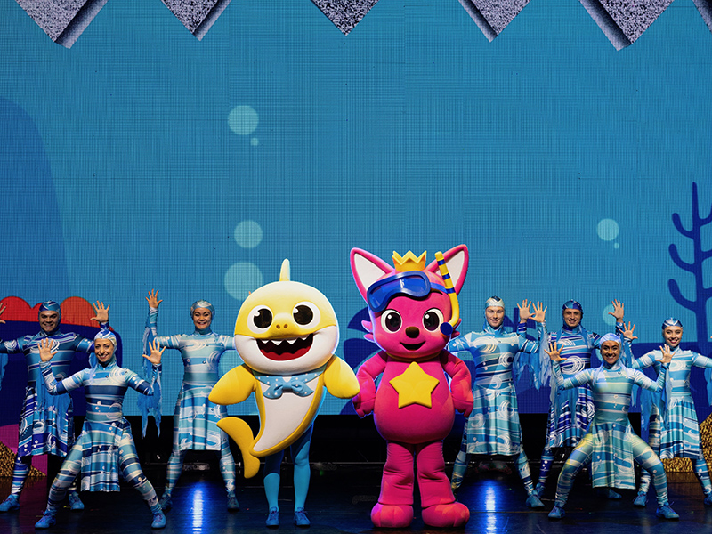 Baby Shark and other characters dancing on stage.