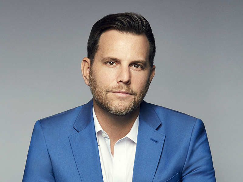 Dave Rubin wearing a blue sport coat.