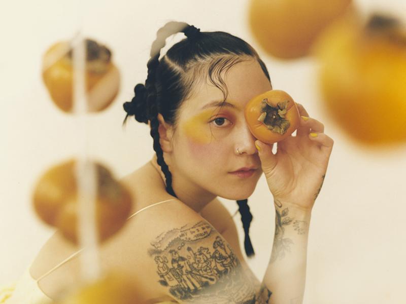 Michelle Zauner holding yellow fruit