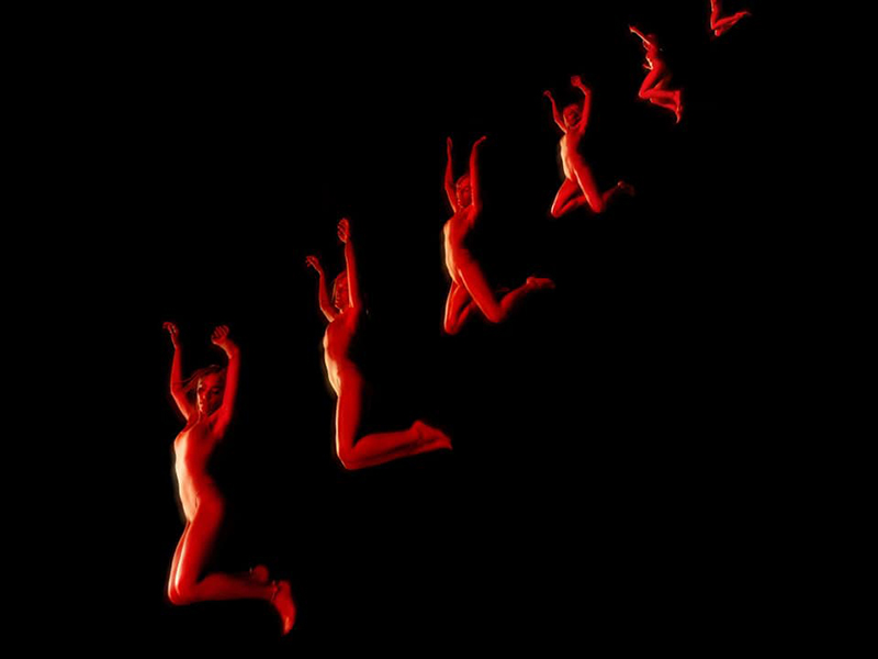 Dark image of a body illuminated in red