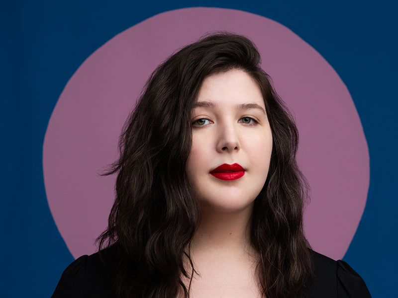 Lucy Dacus with a purple circle behind her head