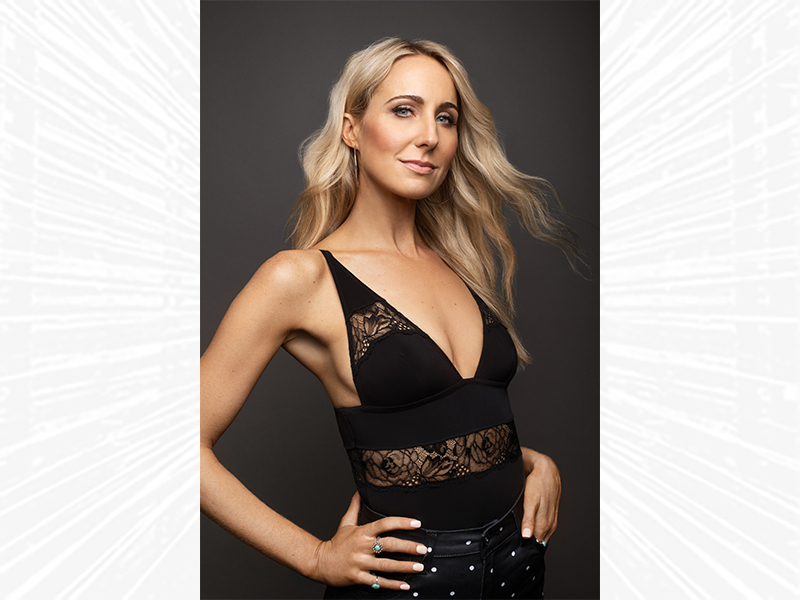 Nikki Glaser standing with her hands on her hips.