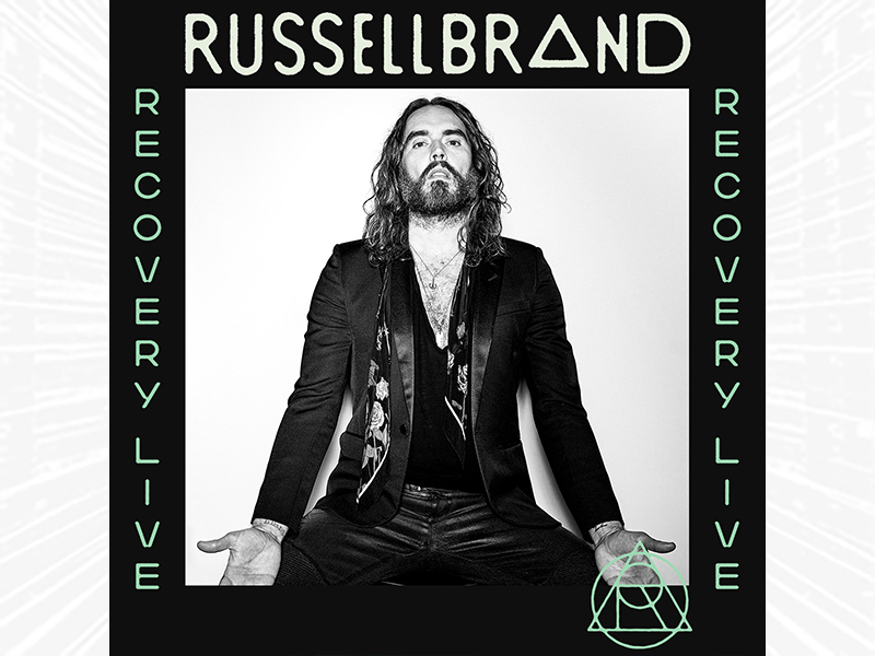 Russell Brand in black and white.