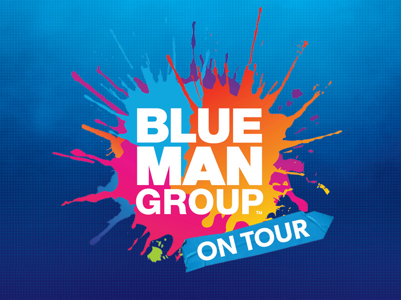 Blue Man Group on tour, in white text, over a splotch of colorful paint.